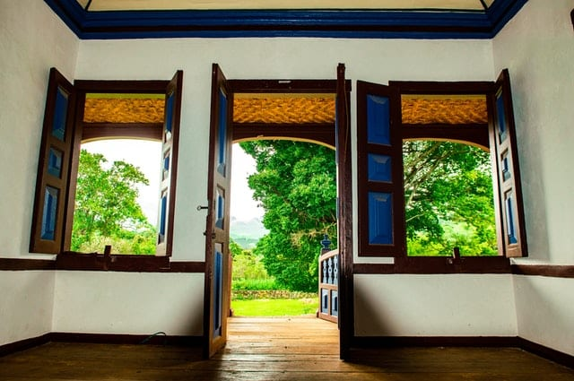 big open windows in a colonial-style mansion