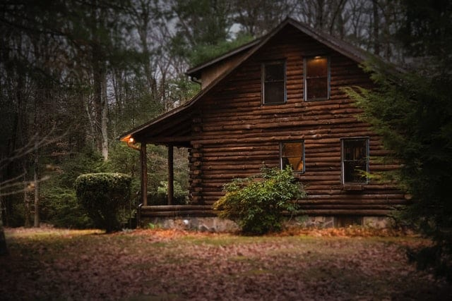 a log cabin in the woods