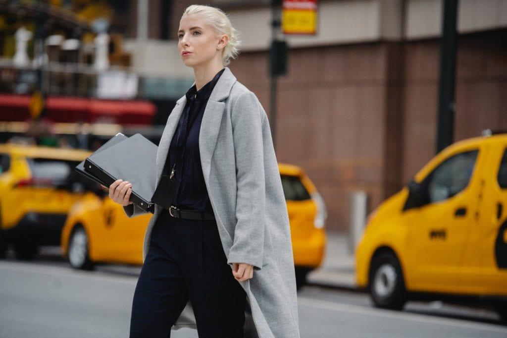 Businesswoman crossing a street