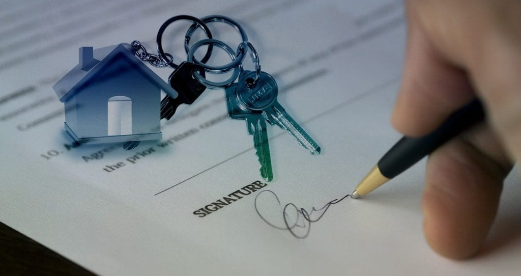 A person signing the contract after purchasing a property