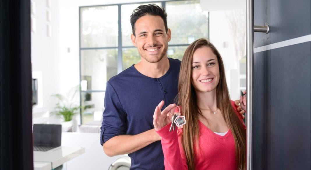 happy young couple at their new house