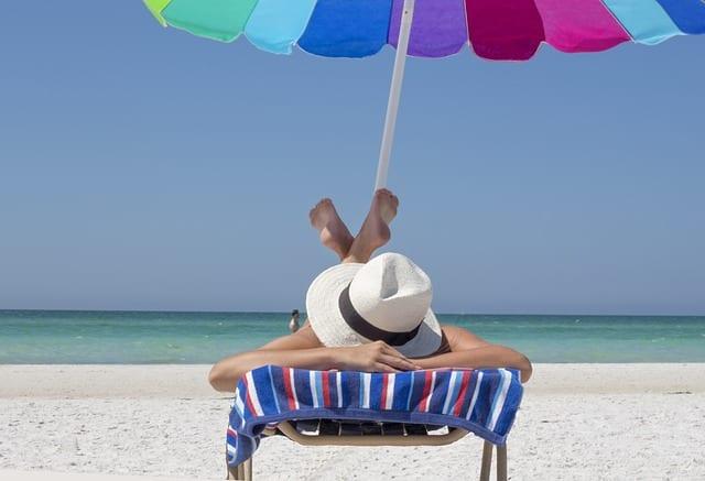a woman enjoying on an empty, peaceful beach