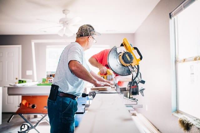 two men building