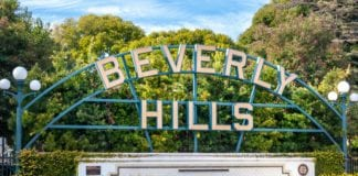 Beverly Hills sign with green trees in the background